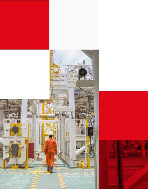 Technician walking through offshore oil and gas platform